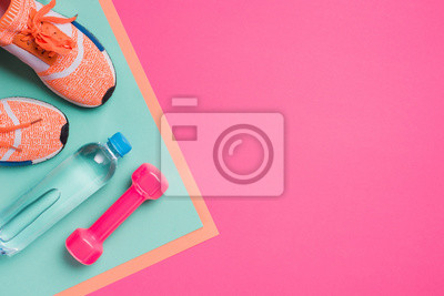 Fototapete Flat lay with sport equipment on pink background