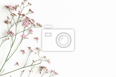 Fototapete Flowers composition. Pink flowers on white background. Flat lay, top view