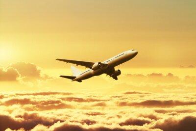 Fototapete Flugzeug im Himmel bei Sonnenuntergang