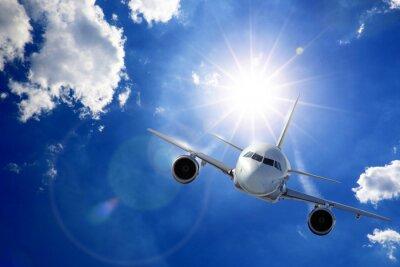 Fototapete Flugzeug in Sonne und Wolken