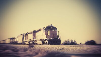 Fototapete Freight train traveling through desert Arizona