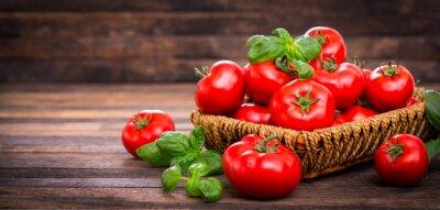 Fototapete Fresh ripe tomatoes and basil in the basket