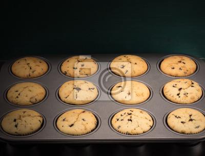 Fototapete Frisch gebackene Muffins in Backform von oben