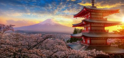 Fototapete Fujiyoshida, Japan Beautiful view of mountain Fuji and Chureito pagoda at sunset, japan in the spring with cherry blossoms