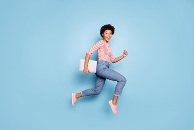 Fototapete Full length body size profile side photo of excited crazy cheerful positive nice pretty sweet youngster wearing jeans denim striped shirt footwear isolated blue pastel color background
