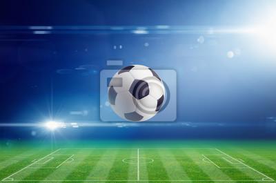 Fußball auf Fußballstadion mit hellem Licht Flare in der Nacht