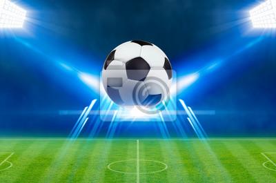 Fußball, helle Scheinwerfer, beleuchtet grünes Fußballstadion