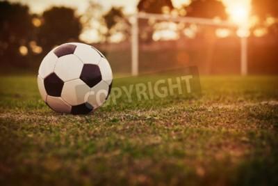 Fototapete Fußball im Sonnenuntergang