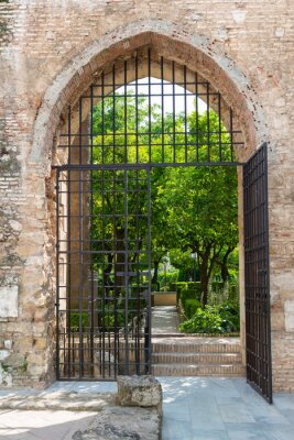 Fototapete Gate to the gardens of the Alcazar in Cordoba