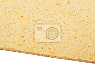 gelben Küchenschwamm ist auf einem weißen isoliert