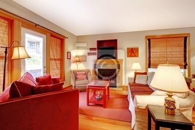 Gemütliches wohnzimmer mit rotem sofa und kamin fototapete ...