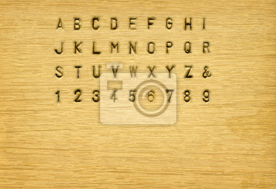 Gestanzt auf Holz Alphabet mit Hintergrund Textur für die Komposition Ihrer Nachricht