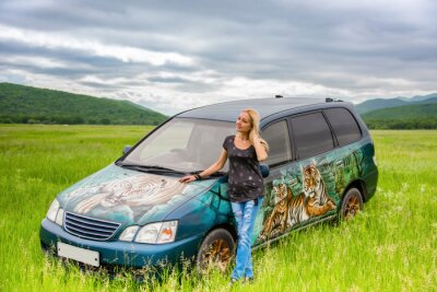 """Girl artist - airbrush painted on his car with the Ussuri tigers. Photo taken in a picturesque valley """"Mirror"""" of Primorsky Krai, Russia"""