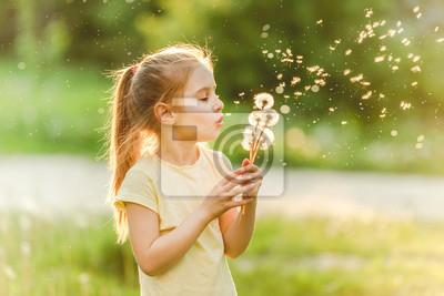 Fototapete Girl blowing at dandelions