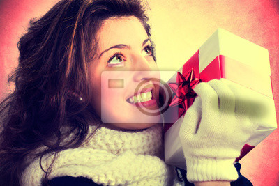 girl in love is holding her gift