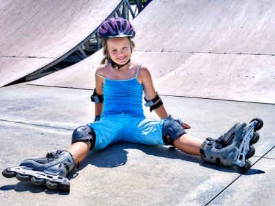 Fototapete Girl riding on roller skates .