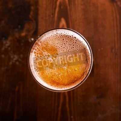 Fototapete glass of beer shot top down