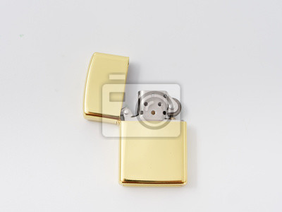 Fototapete golden gasoline lighter with a wick on a white background.