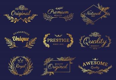 Fototapete Golden ornament labels. Luxury floral badges and logo with leaf, flowers and crown. Vintage gold royal premium flourishes element vector set