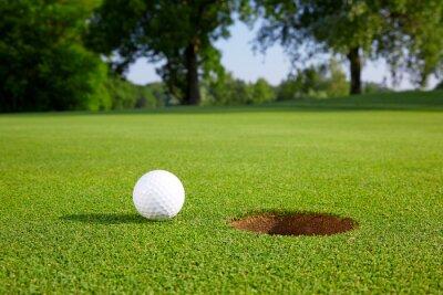 Fototapete Golf ball on the green