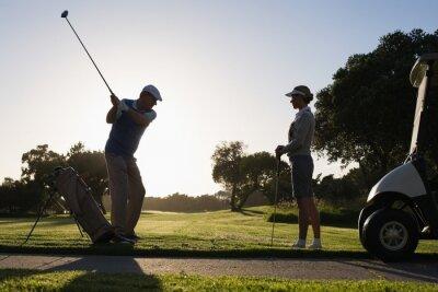 Fototapete Golfen paar Abschlag für den Tag