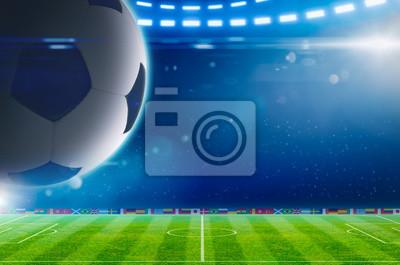 Großer Fußball über grünem Stadion mit hellen Scheinwerfern