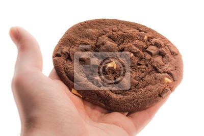 Fototapete Großer Schokoladenkeks in der Hand