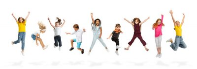 Fototapete Group of elementary school kids or pupils jumping in colorful casual clothes on white studio background. Creative collage.