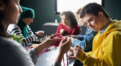 Fototapete Group of people playing cards and board games in community center, inclusivity of disabled person.