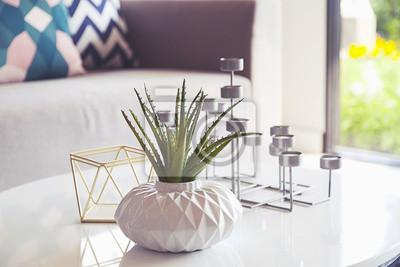 Fototapete Grüne Pflanze in einer Vase und Kerzenständer im Wohnzimmer