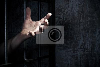 Hand des Gefangenen