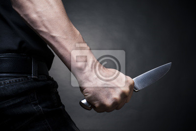 Hand mit einem Messer