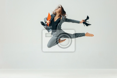 Fototapete Happy business woman dancing and smiling in motion isolated over white studio background. Human emotions concept. The businesswoman, office, success, professional, , happiness, expression concepts