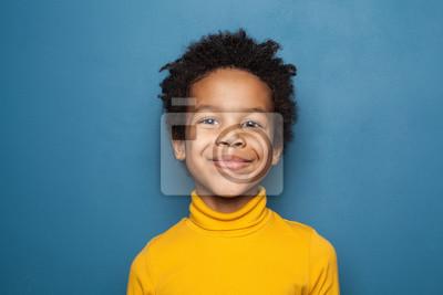 Fototapete Happy child portrait. Little african american kid boy on blue background