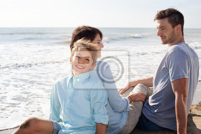 Happy Family Sitting at the Beach
