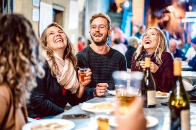 Fototapete Happy friends having fun drinking white wine at street food festival - Young people eating local plate at restaurant reopening together - Travel and dinning lifestyle concept on azur light neon filter