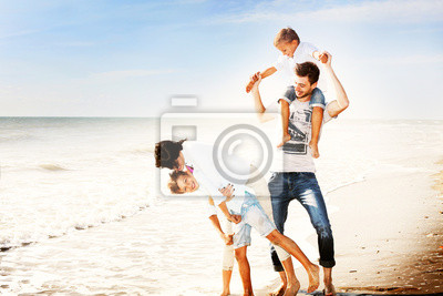 Happy Small Family at the Beach