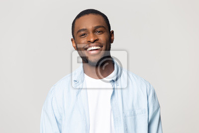 Fototapete Head shot portrait happy African American man with healthy smile