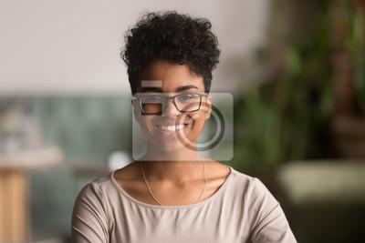 Fototapete Headshot portrait of happy mixed race african girl wearing glasses