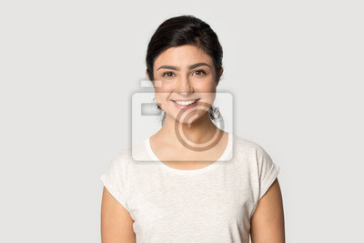 Fototapete Headshot portrait of smiling indian girl posing in studio