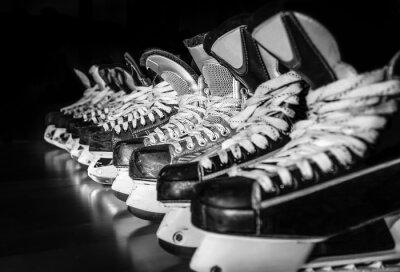 Fototapete Hockey skates lined up in locker room
