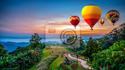 Fototapete Hot air balloons adventure in nature over winter mountain in Chiang Mai, Thailand.