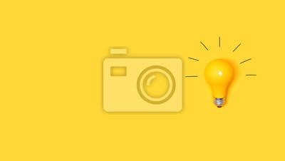 Fototapete Idea light bulb on a vivid yellow background