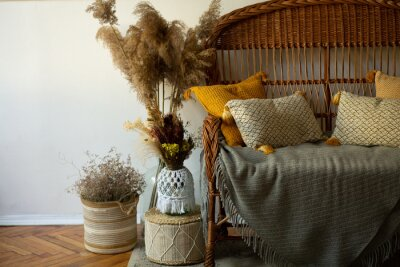 Fototapete interior in autumn style, living room decor, wicker furniture, beautiful pillows, dried flowers