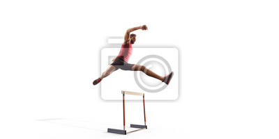 Fototapete Isolated Male Track and field athlete jumps over the barrier on white background