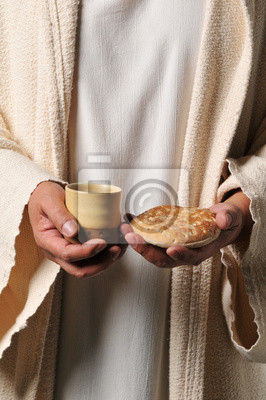 Jesus hält ein Brot und ein Wein