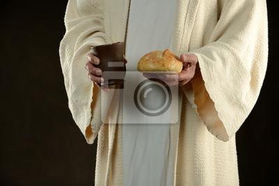 Jesus holding Brot und ein Becher Wein