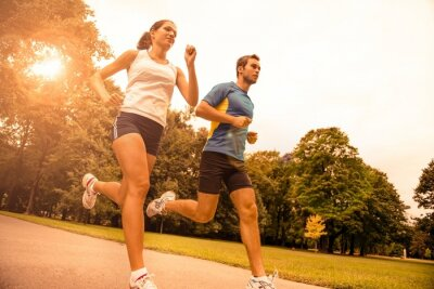Fototapete Jogging together - sport young couple