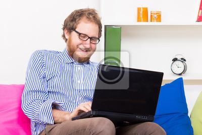 Joyful man chatting by computer