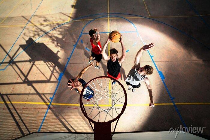 Fototapete junge Basketball-Spieler spielen mit Energie